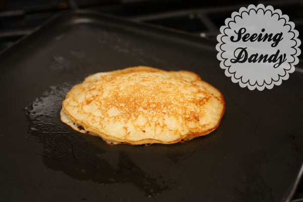 Cooking breakfast Cream of Wheat pancake on an electric skillet.