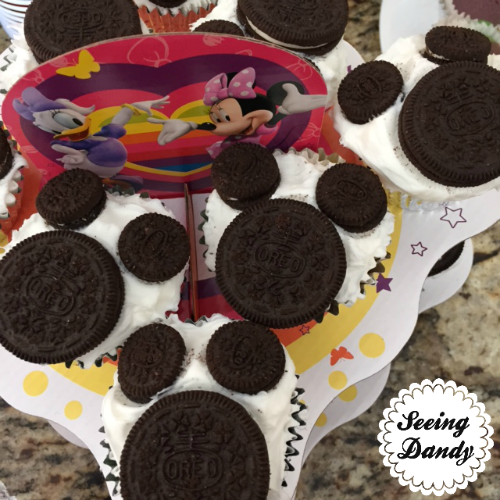 Mickey Mouse cupcakes with Oreo cookies on Disney cake stand.