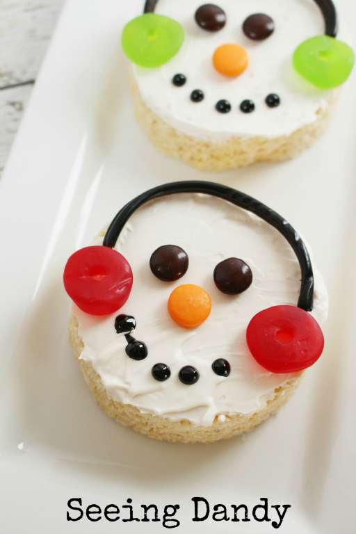 Snowman rice krispies treats made with candy, licorice, chocolate, and life savers.