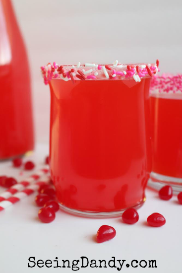 DIY Valentine's Day punch with Red Hots, edible sprinkles and decorative straws.