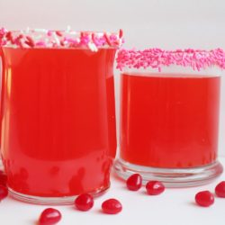 Red Hots Valentines Day punch glasses with decorative sprinkles.