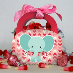 DIY elephant Valentine treat bags with Valentine's Day candy.