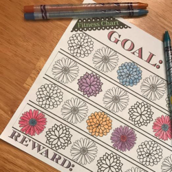 Fitness reward chart with color pencils.