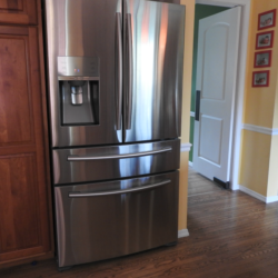 Cleaning stainless steel refrigerators in the kitchen.