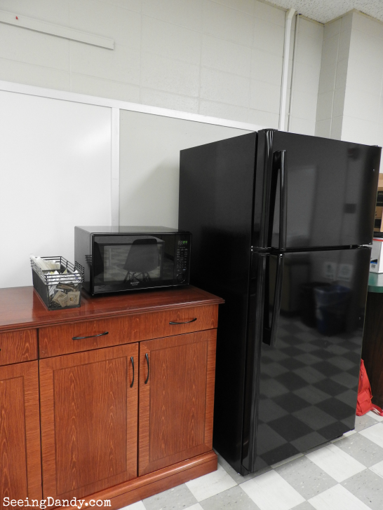 Sherwin Williams gray paint and Appliance Discounters black refrigerator.