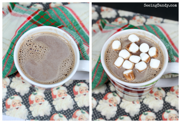 Nutella hot chocolate with mini marshmallows, plaid Christmas napkin and Santa Claus scrapbook paper.