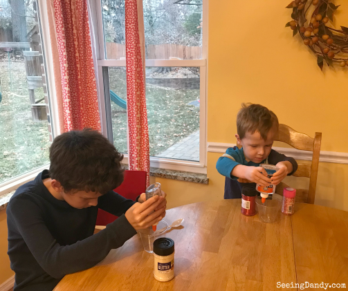 Kids making slime at the kitchen table. Easy to make Valentine's Day cards.