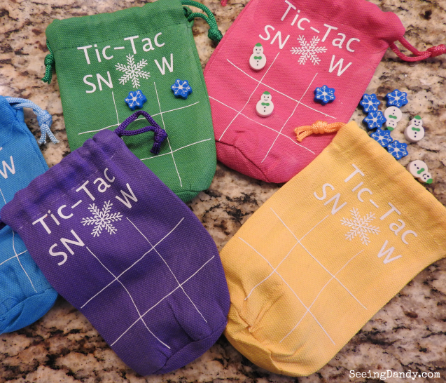 Multi color Tic Tac Snow Bags with snowman and snowflake erasers.