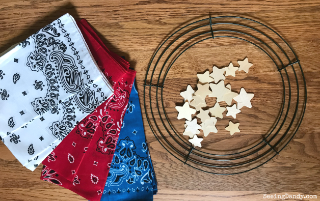 Red, white and blue bandanas, wire wreath and wooden stars.