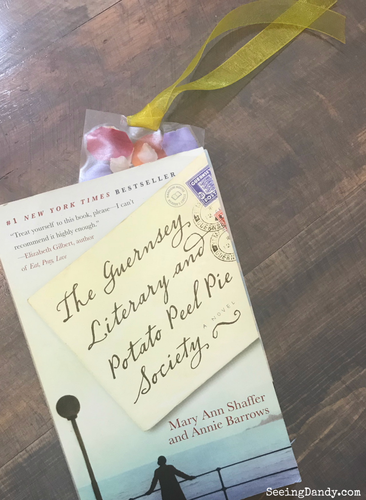 The Guernsey Literary and Potato Peel Pie Society book with pressed flowers bookmark.