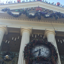 Disneyland haunted mansion decorated for Christmas and Halloween.