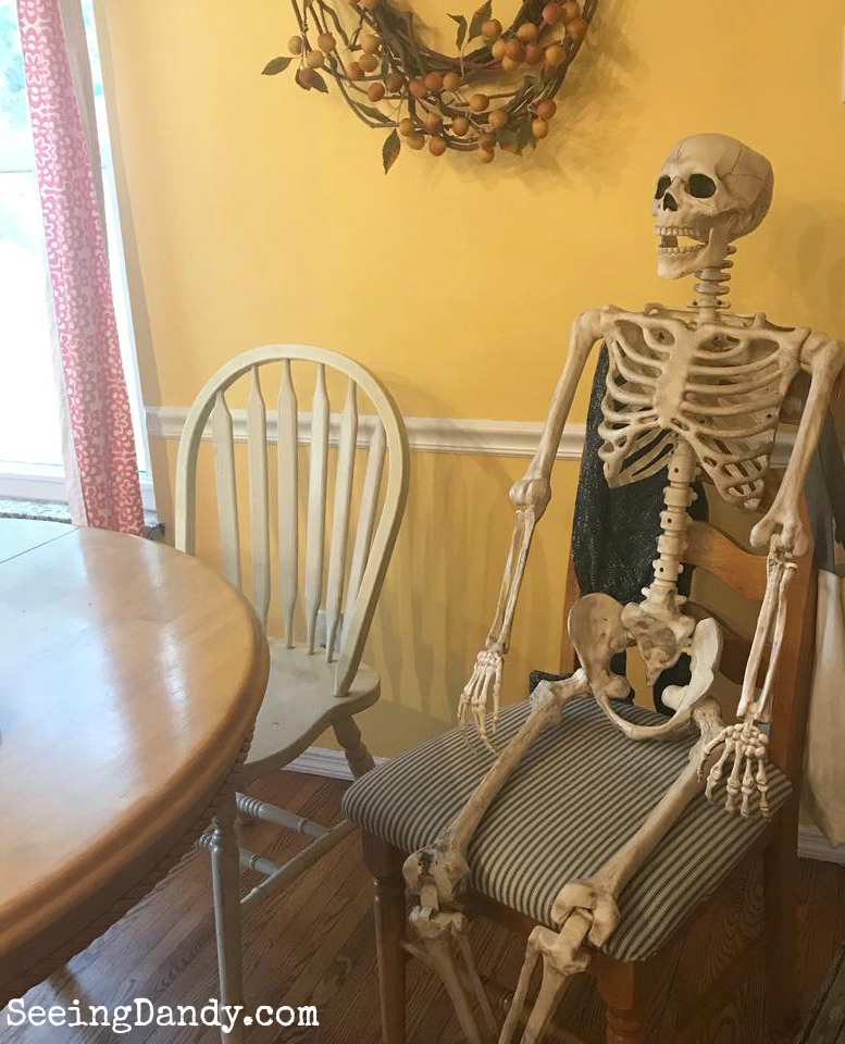 Skeleton at the kitchen table to decorate like the Haunted Mansion.