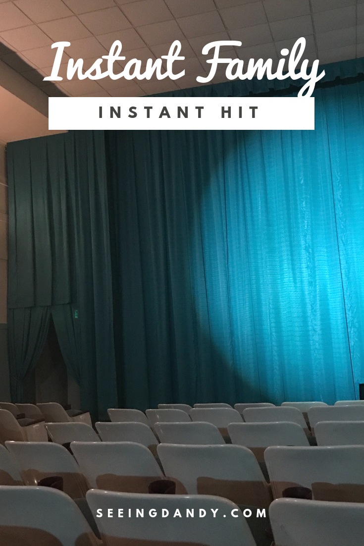 The Instant Family movie title on a picture of a vintage theater in St. Louis.