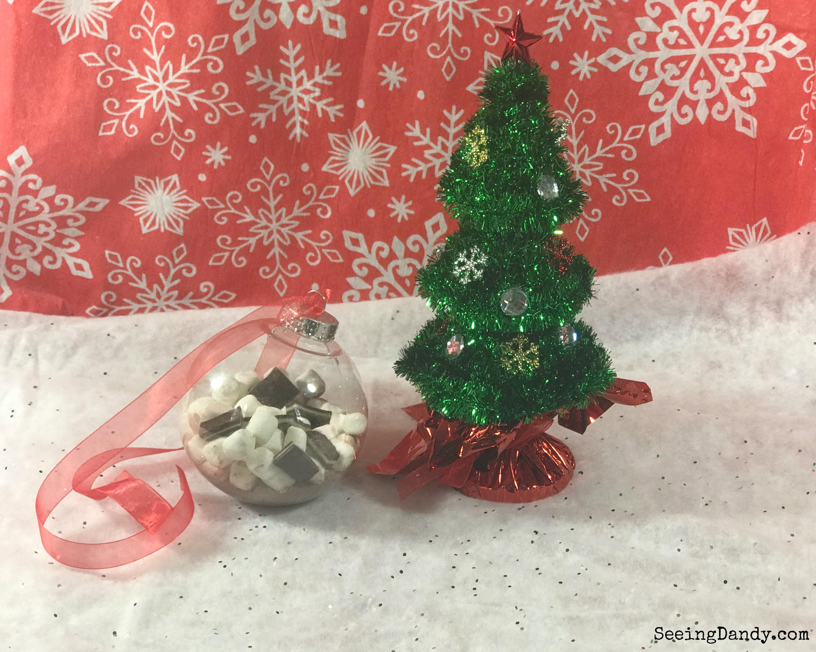 Miniature decorated Christmas tree with snowflake background and Hot Cocoa Mix Ornaments.