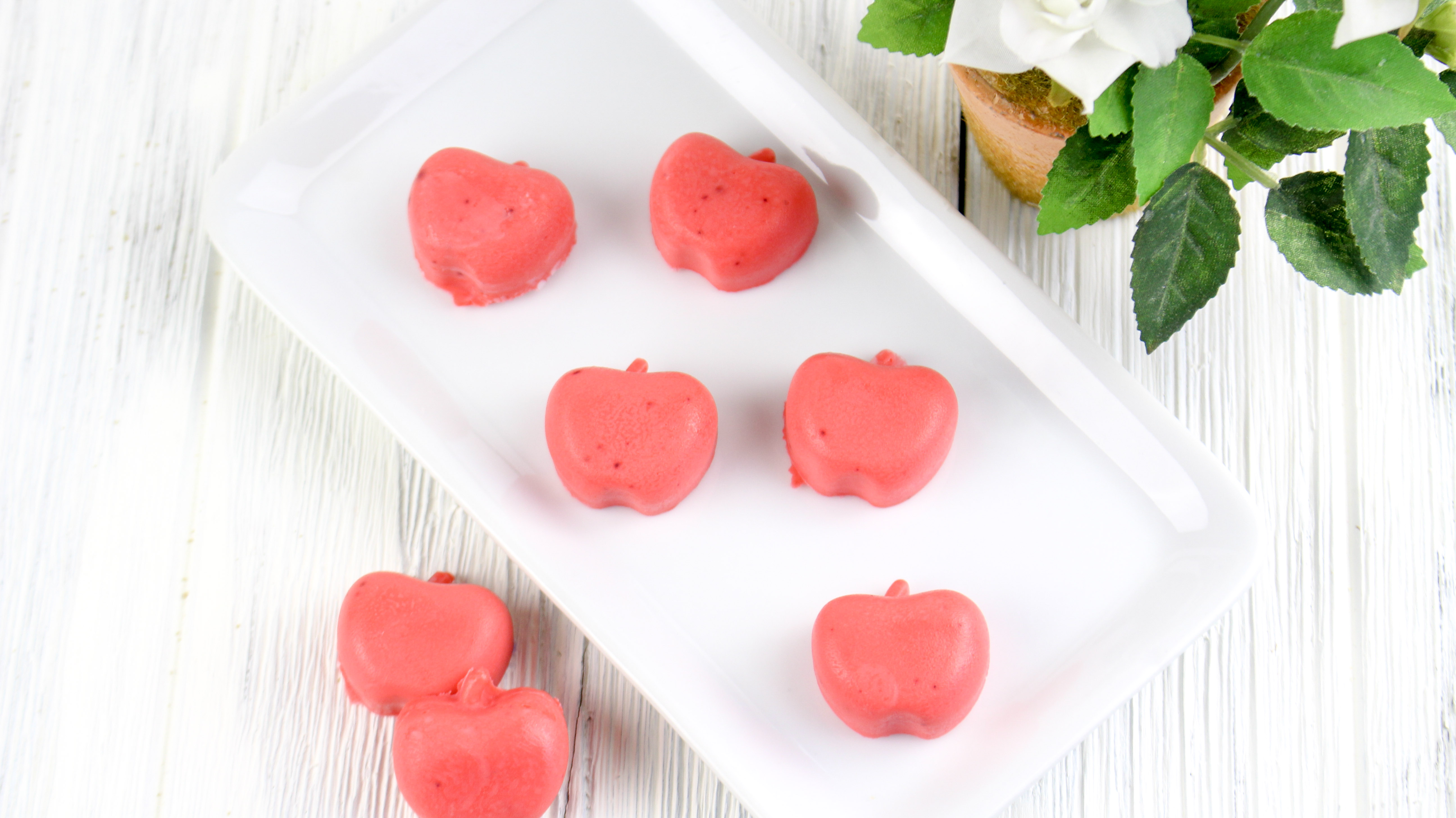Easy to make DIY teacher Christmas gift. Red apple scented lotion bars with white flower.