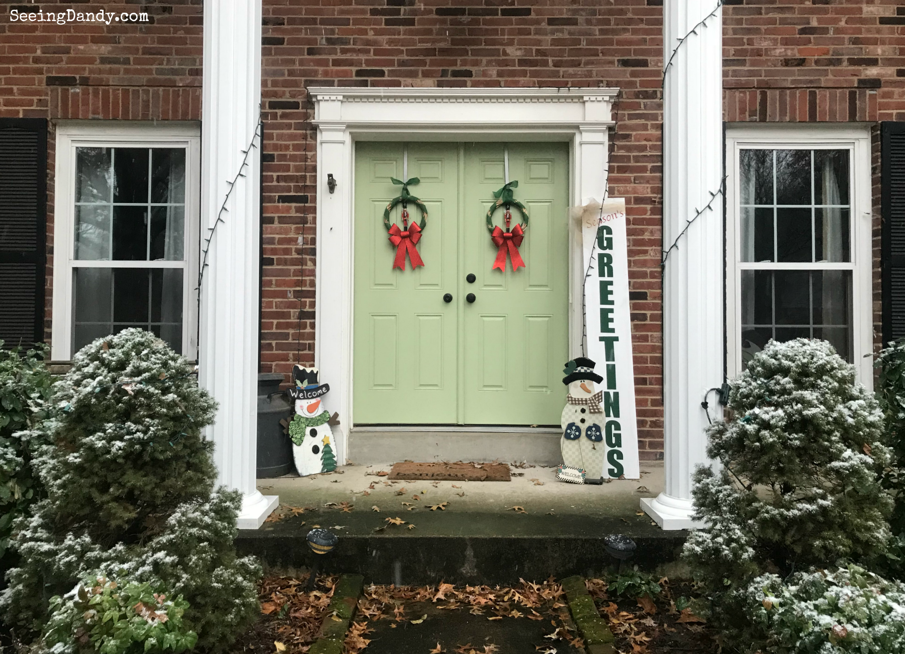 Front porch DIY Nutcracker Christmas wreath and Christmas decorations.
