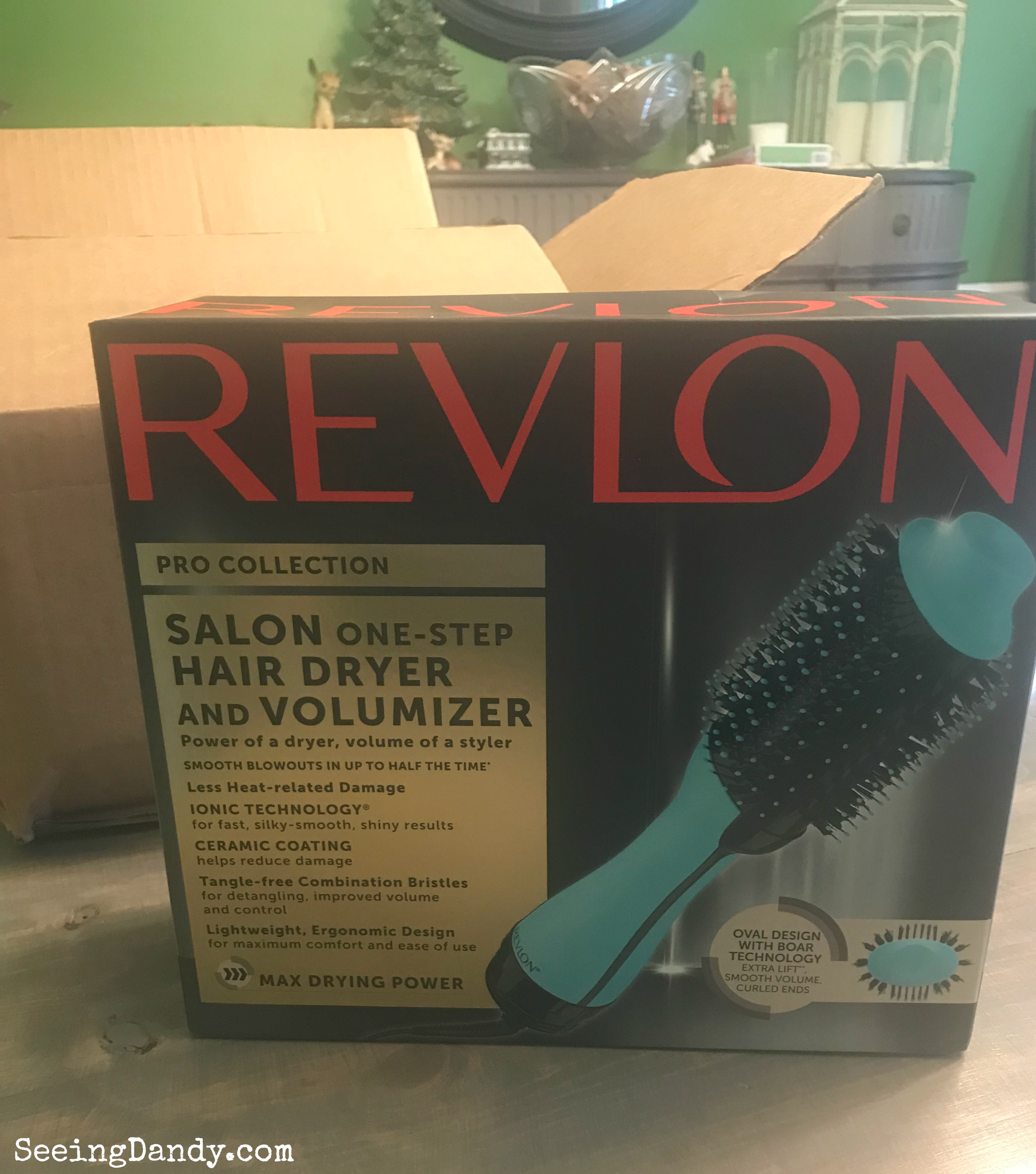 Revlon One Step Hair Dryer and Volumizer unboxing in modern farmhouse dining room. Box on farmhouse table with ceramic Christmas tree and other holiday decorations in the background.