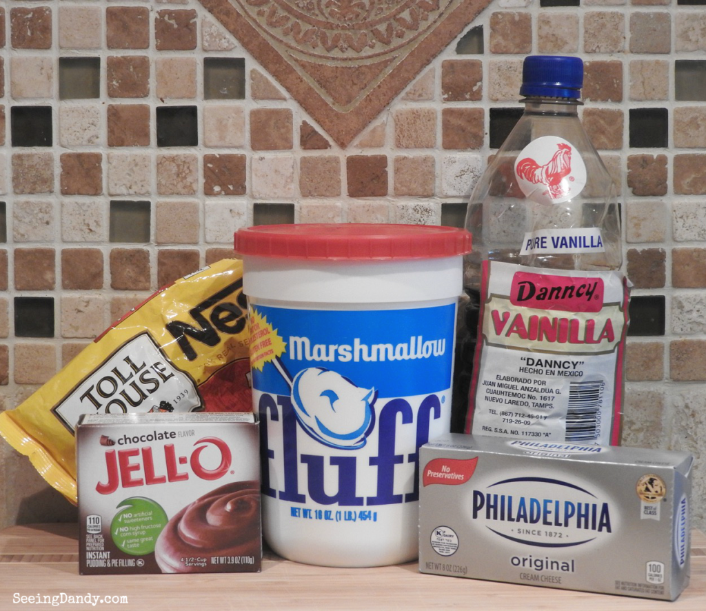 Ingredients for making Fluffy Chocolate Fruit Dip with kitchen backsplash tile. Toll House chocolate chips, cream cheese, chocolate pudding, marshmallow fluff, mexican vanilla.