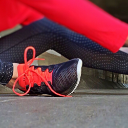 Easy health and wellness ideas. Black and red running shoes with exercise clothing.