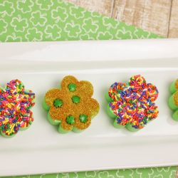 Shamrock shake fudge recipe on farmhouse table with St. Patrick's Day scrapbook paper.
