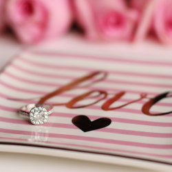 Valentine's Day jewelry deals with pink roses on love plate.