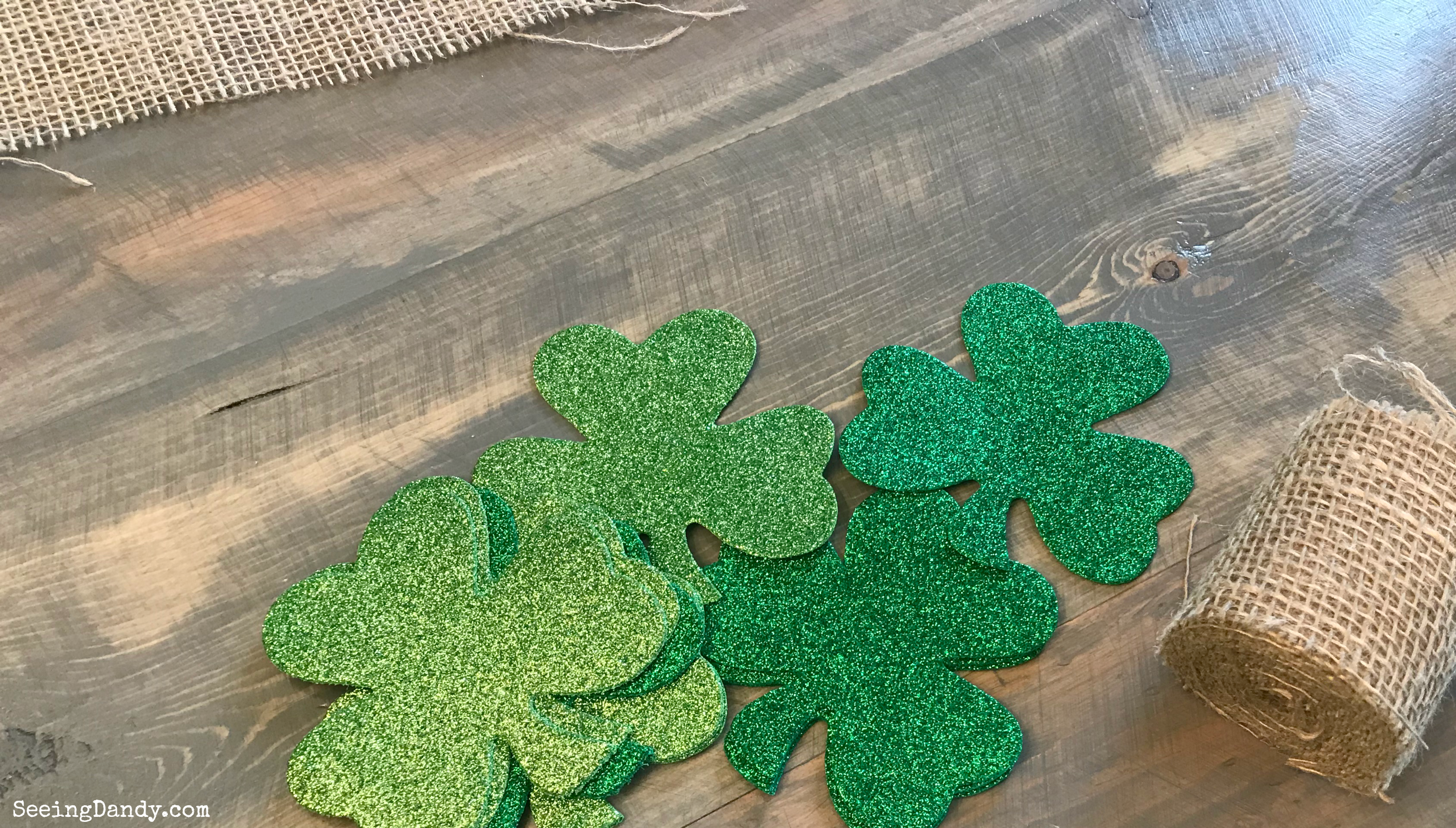 Materials for making a burlap shamrock table runner.