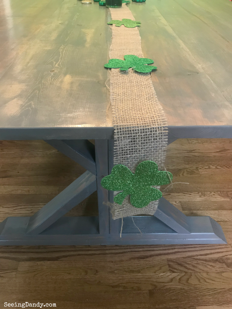 Burlap shamrock table runner decorating a farmhouse table.