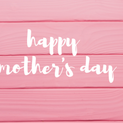 Happy Mothers Day with baby's breath and pink wooden background.