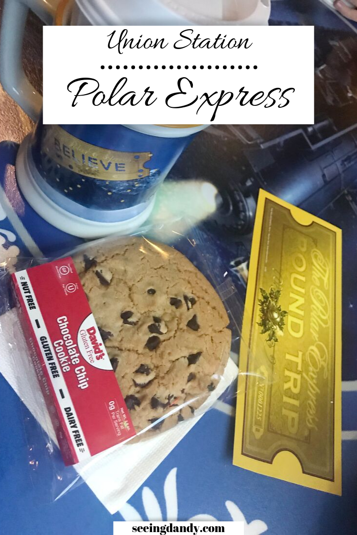 Polar Express tickets with hot chocolate, Polar Express mug and chocolate chip cookie in deluxe train car.