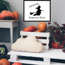 Halloween entry way home decor with pumpkins and Hocus Pocus Halloween wall art.