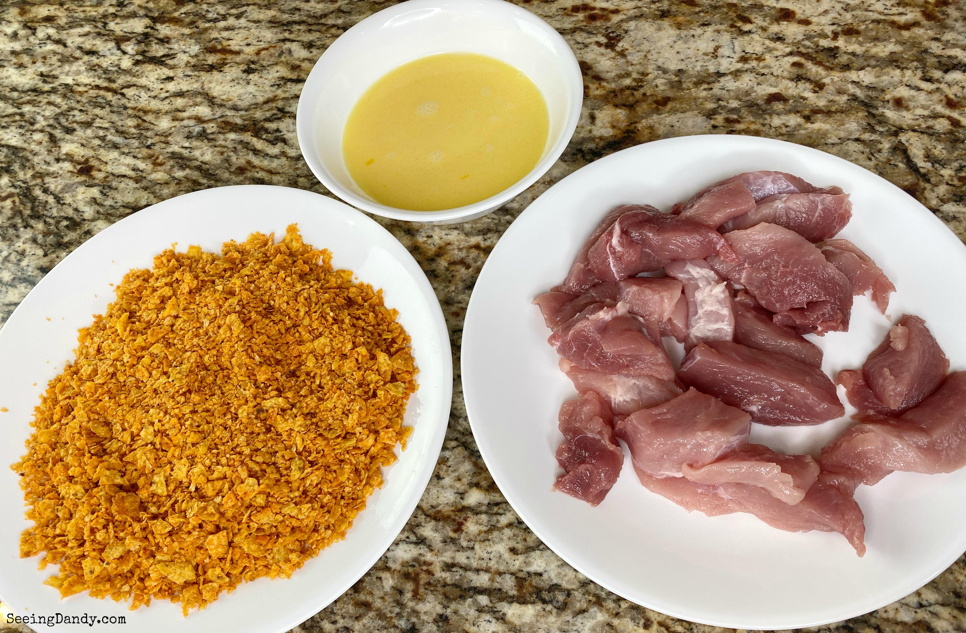 Crushed Doritos, pork sirloin strips, and blended egg.