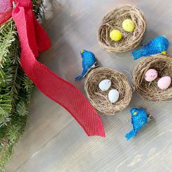 Blue bird nest Christmas tree ornament with pine swag red ribbon