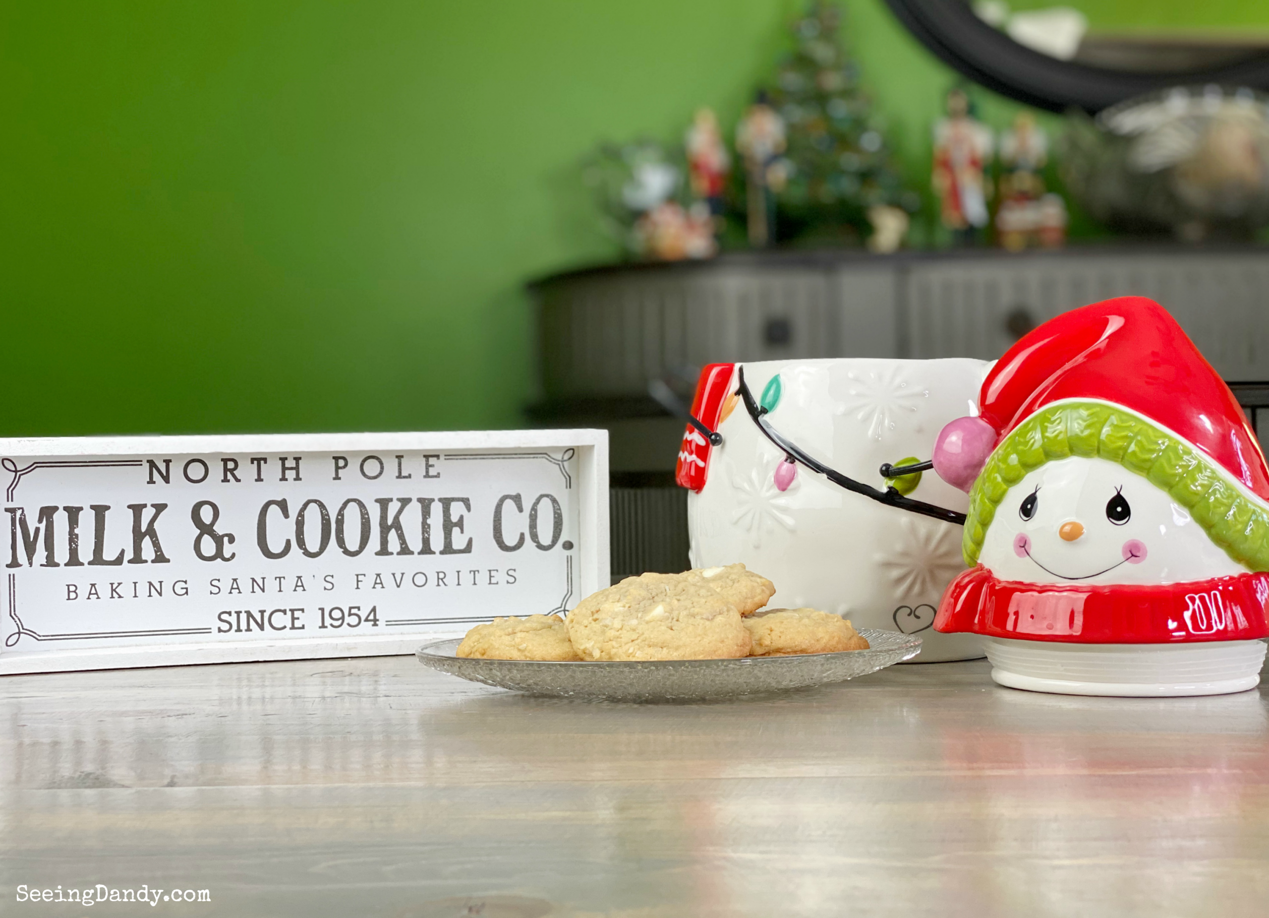 Precious Moments snowman cookie jar with Target Christmas sign and holiday cookies.
