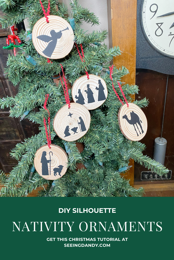 Farmhouse style DIY nativity Christmas tree ornaments on Christmas tree antique clock.