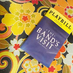 The Band's Visit Playbill on floral background