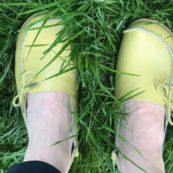 Apple green yellow moccasins in grass.