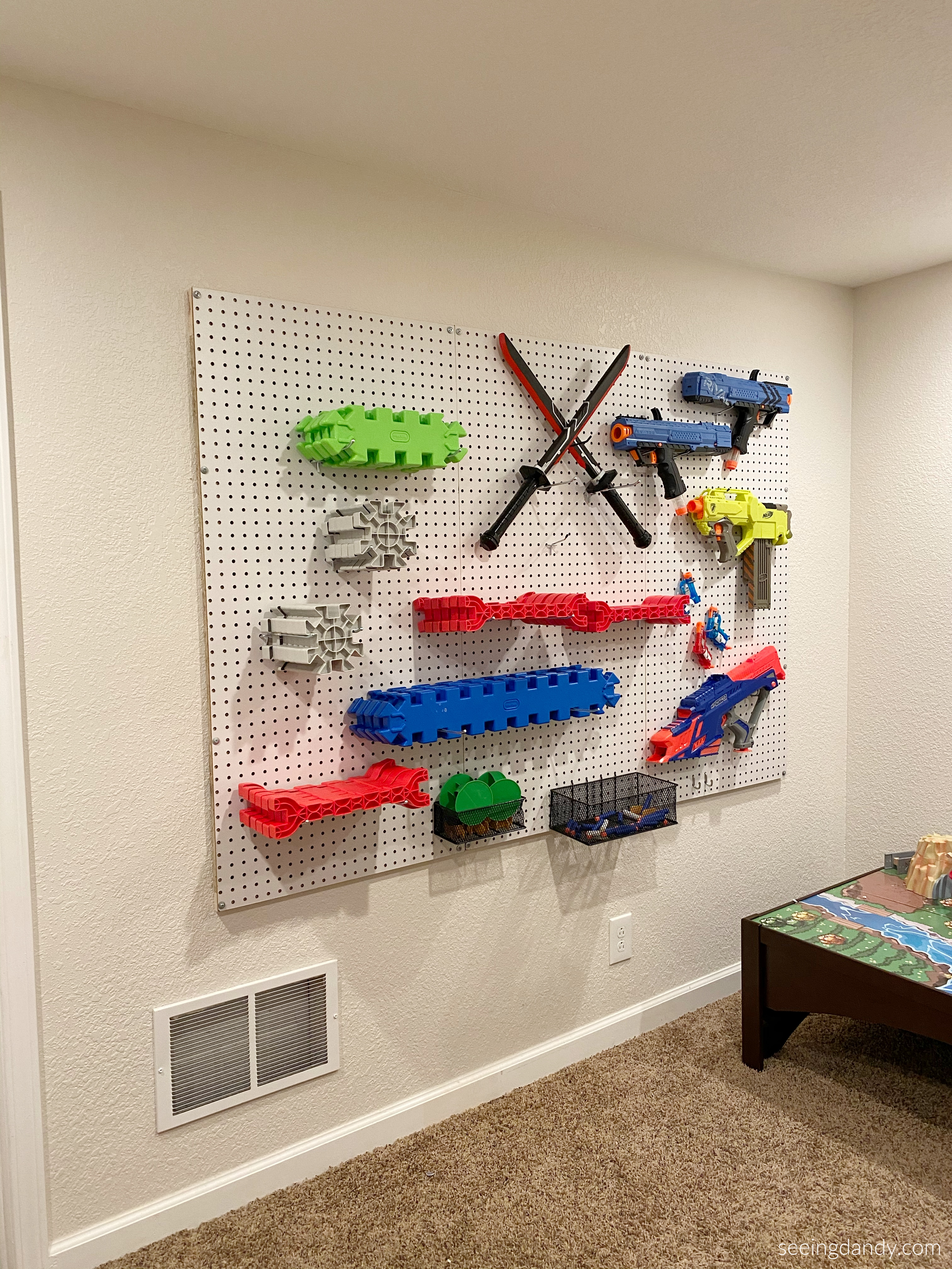 Easy to build nerf gun storage wall organizing playroom idea