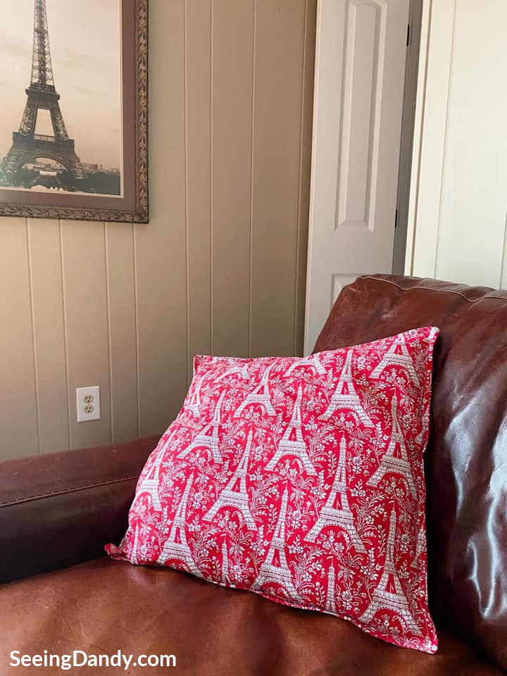 red eiffel tower pillow, eiffel tower photograph artwork, painted wood paneled wall
