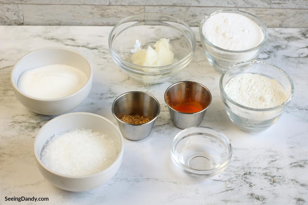 ingredients for citrus bath bomb recipe, epsom salt, essential oils, vanilla, coconut oil, dried orange peel