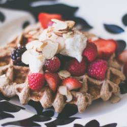 Belgian delicious waffle with strawberries blackberries cream, almonds