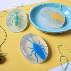 kids bug soap, yellow paper, plastic bugs, green white stripe string