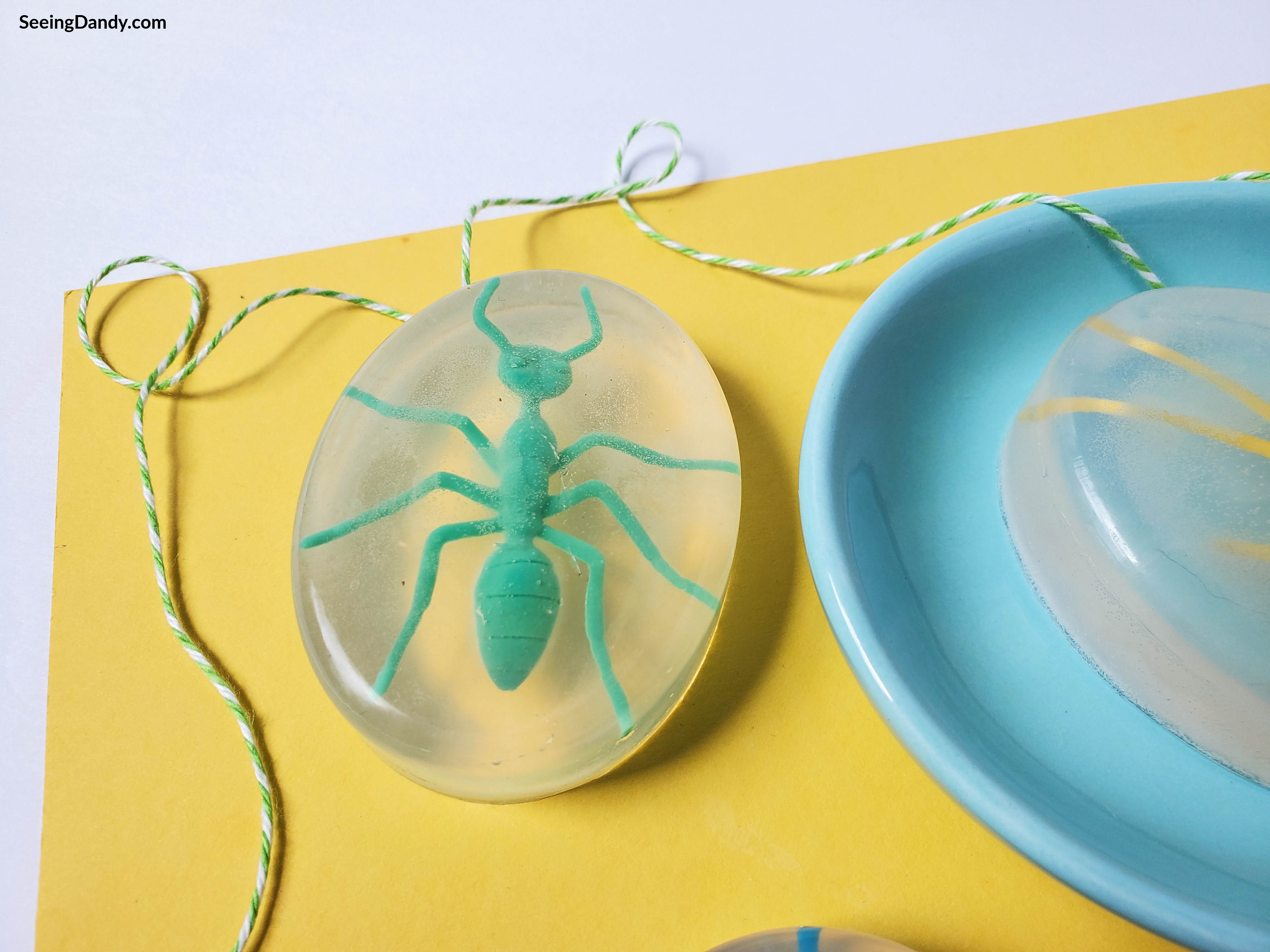 diy soap, kids crafts, green plastic ant, plastic bugs, soap making, green white stripe string, yellow paper, blue soap dish, kids bug soap