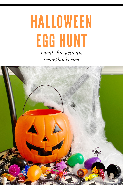 Halloween Egg Hunt idea, fall family activity, halloween fun, halloween ideas, family activities, holidays, halloween eggs, orange pumpkin bucket, halloween trinkets, farmhouse style chair, witch fabric, halloween candy, halloween diy