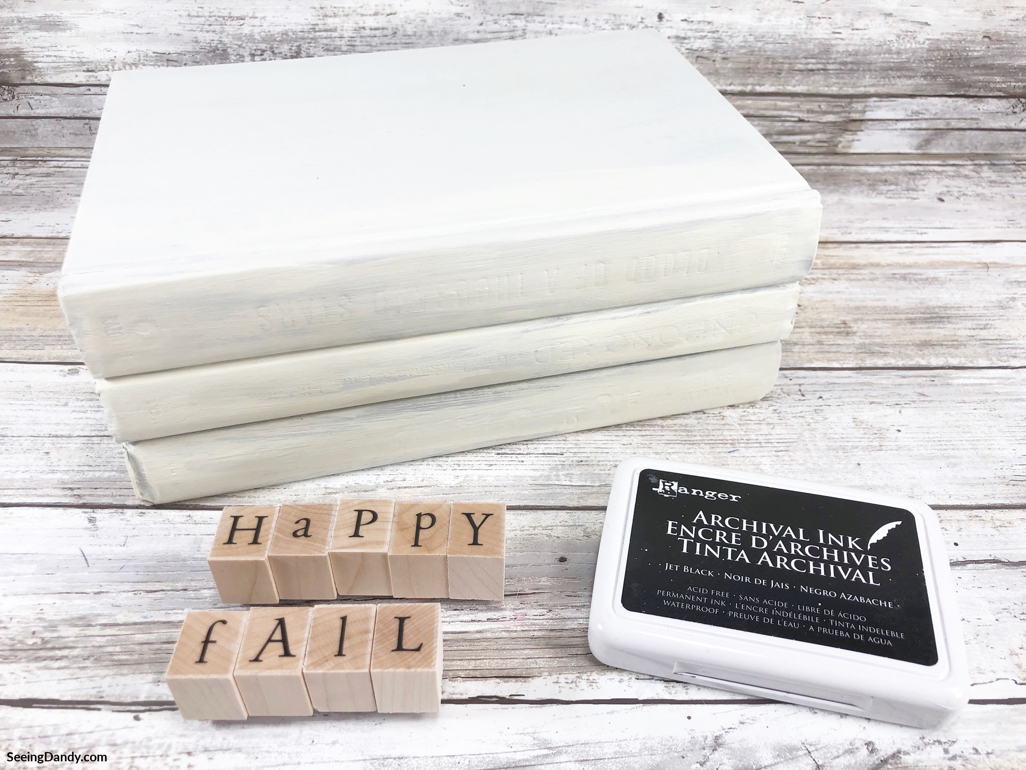 diy stamped book stacks, easy crafts, dollar tree crafts, wooden stamps, happy fall