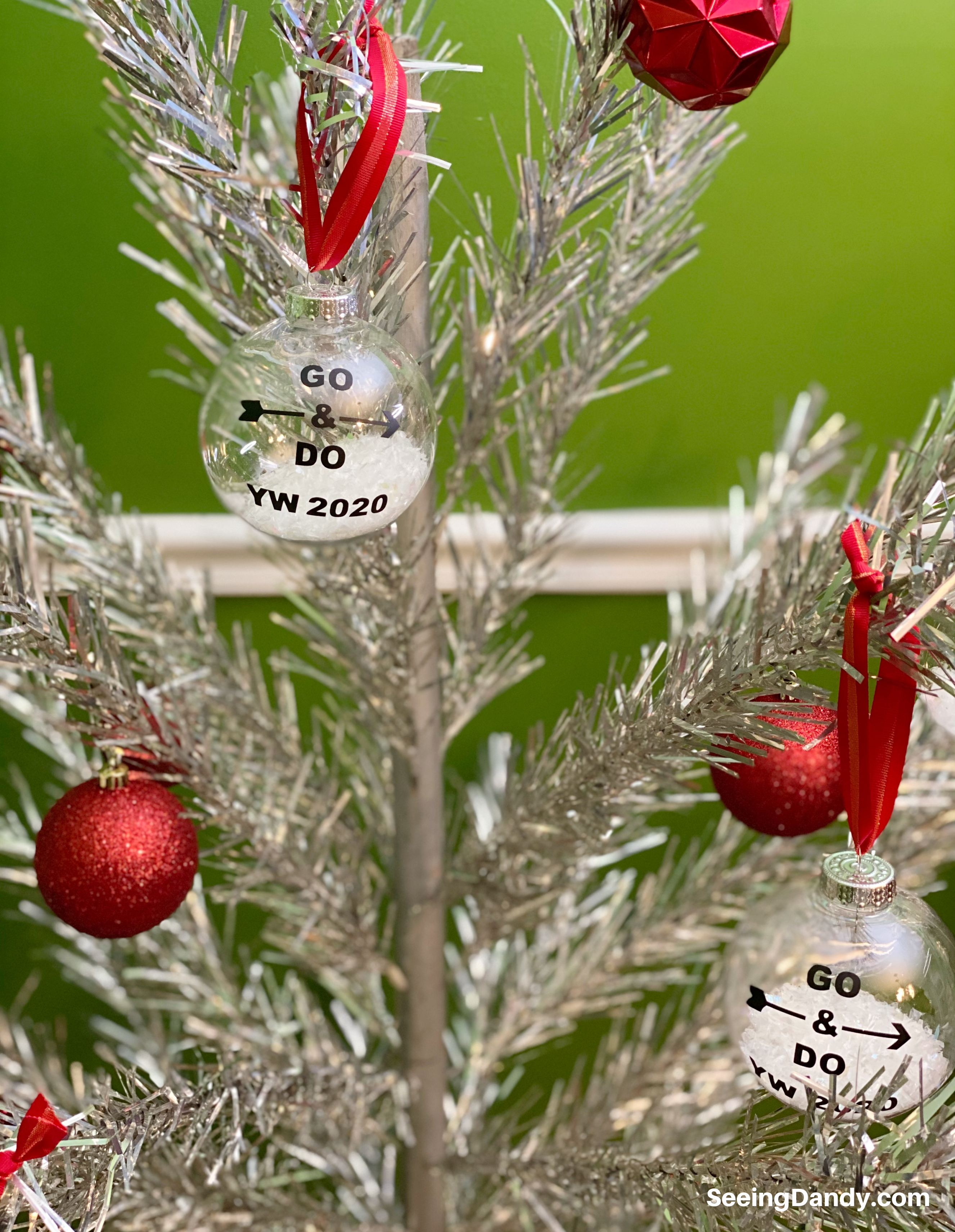 aluminum christmas tree, lds christmas ornaments, craft ornaments, DIY YW Christmas ornament, 2020 youth theme, go and do, the church of jesus christ of latter day saints, easy to make christmas ornaments, free svg file, red ribbon, clear ball ornaments, plastic ornaments, vintage christmas tree, red retro ornaments, silver tree