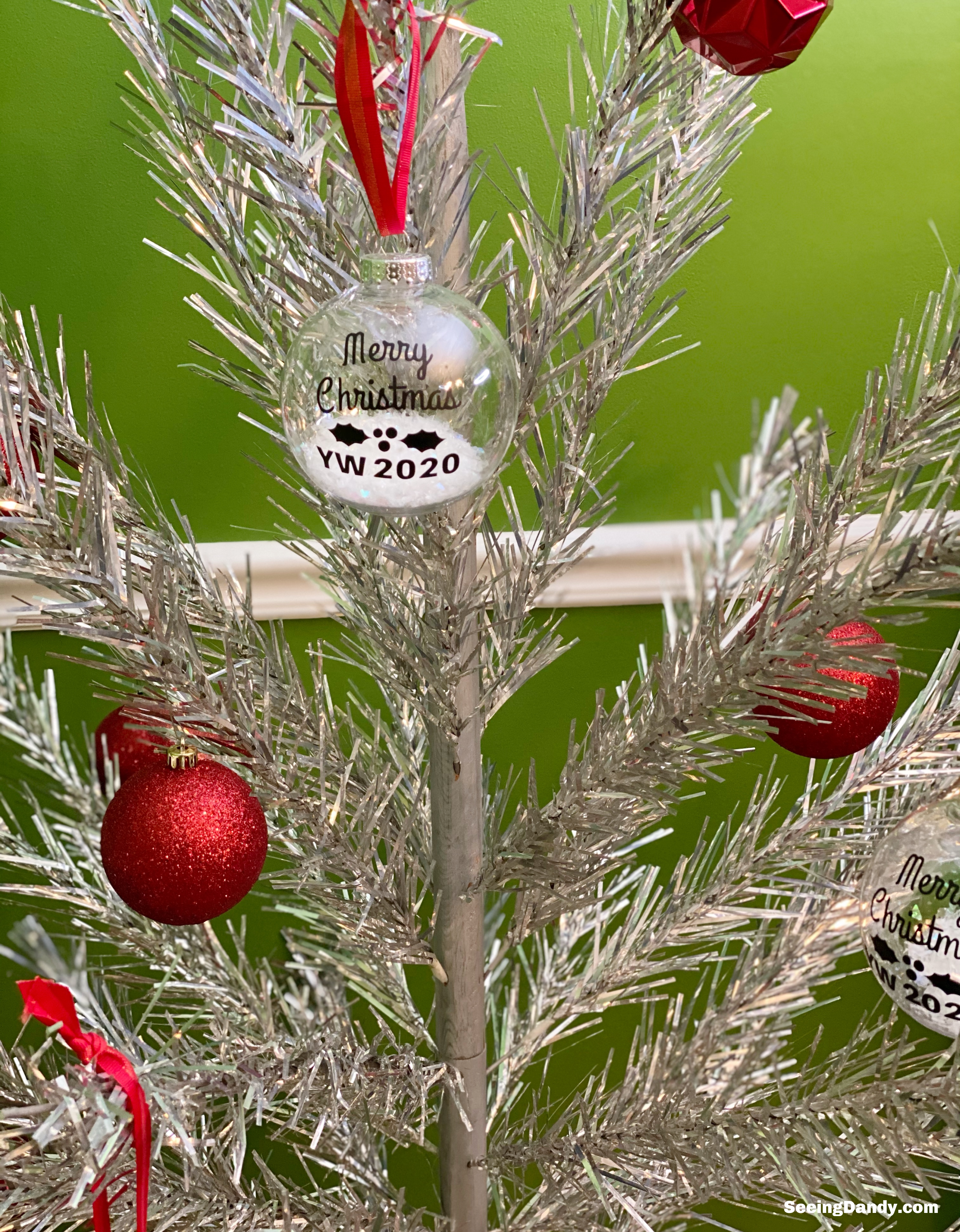 easy to make yw christmas ornament, diy christmas ornaments, clear plastic ball ornaments, merry christmas svg file, free svg file, tinsel tree, silver christmas tree, aluminum christmas tree, red shatter proof ornaments, vintage christmas tree, yw crafts
