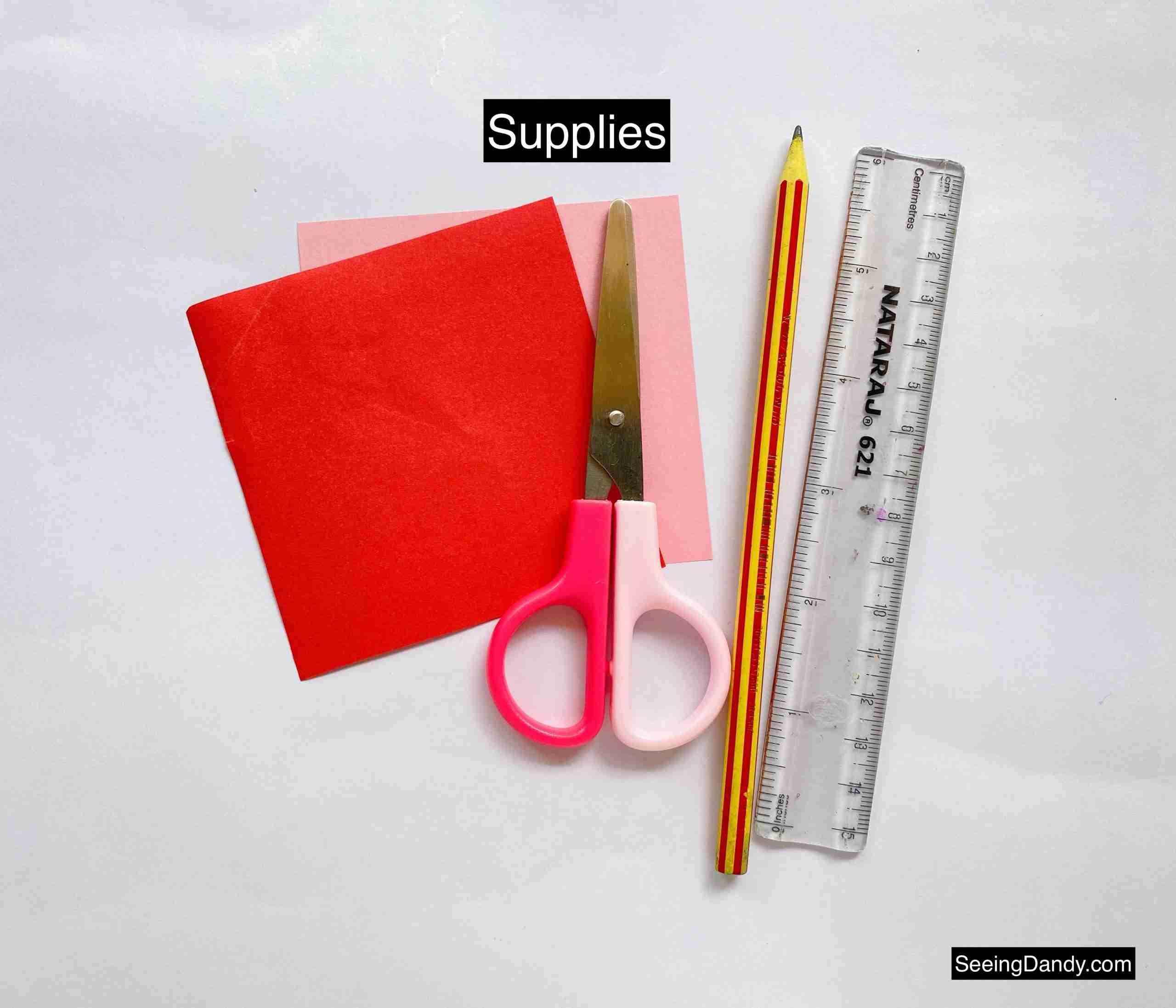 origami paper, scissors, craft supplies, stripe pencil, clear ruler