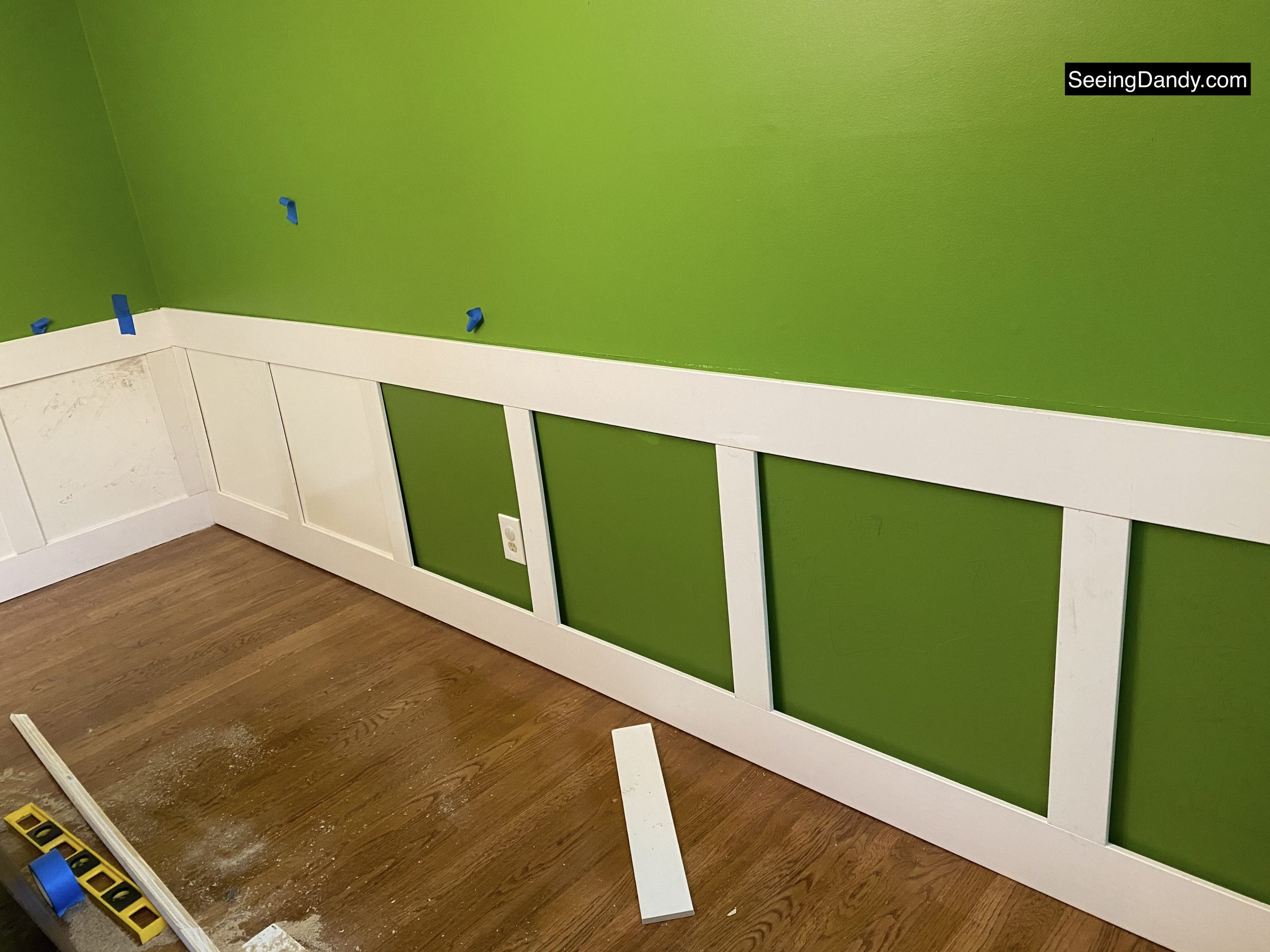 diy wainscoting, dining room wainscoting, kate spade green wall, behr paint, bold avocado green wall, square wainscoting, dining room decor, farmhouse style decorating, dining room hardwood floor