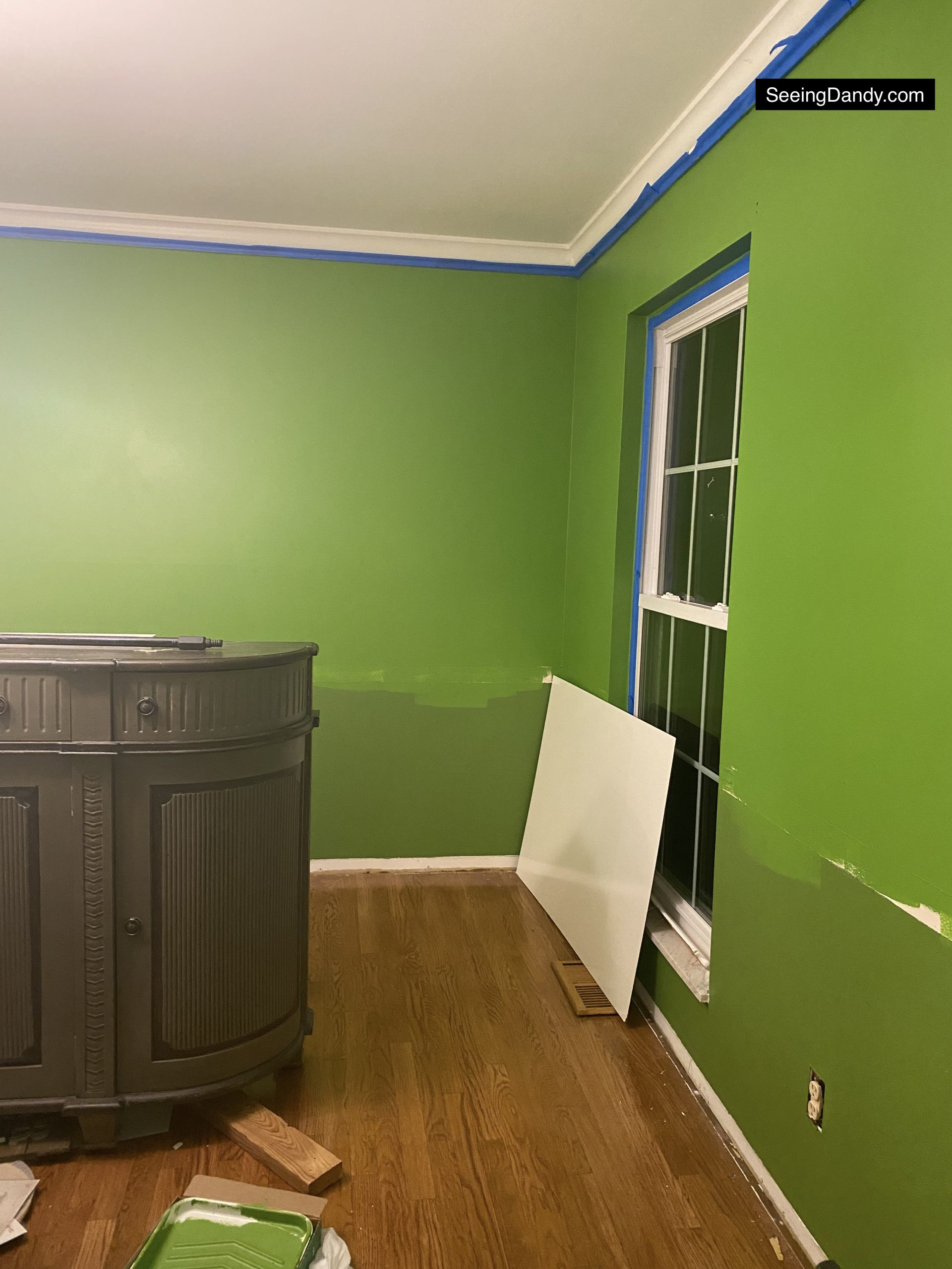 diy wainscoting, dining room wainscoting, kate spade green wall, behr paint, bold avocado green wall, square wainscoting, dining room decor, farmhouse style decorating, white crown molding, stash furniture farmhouse style sideboard, dining room hardwood floor