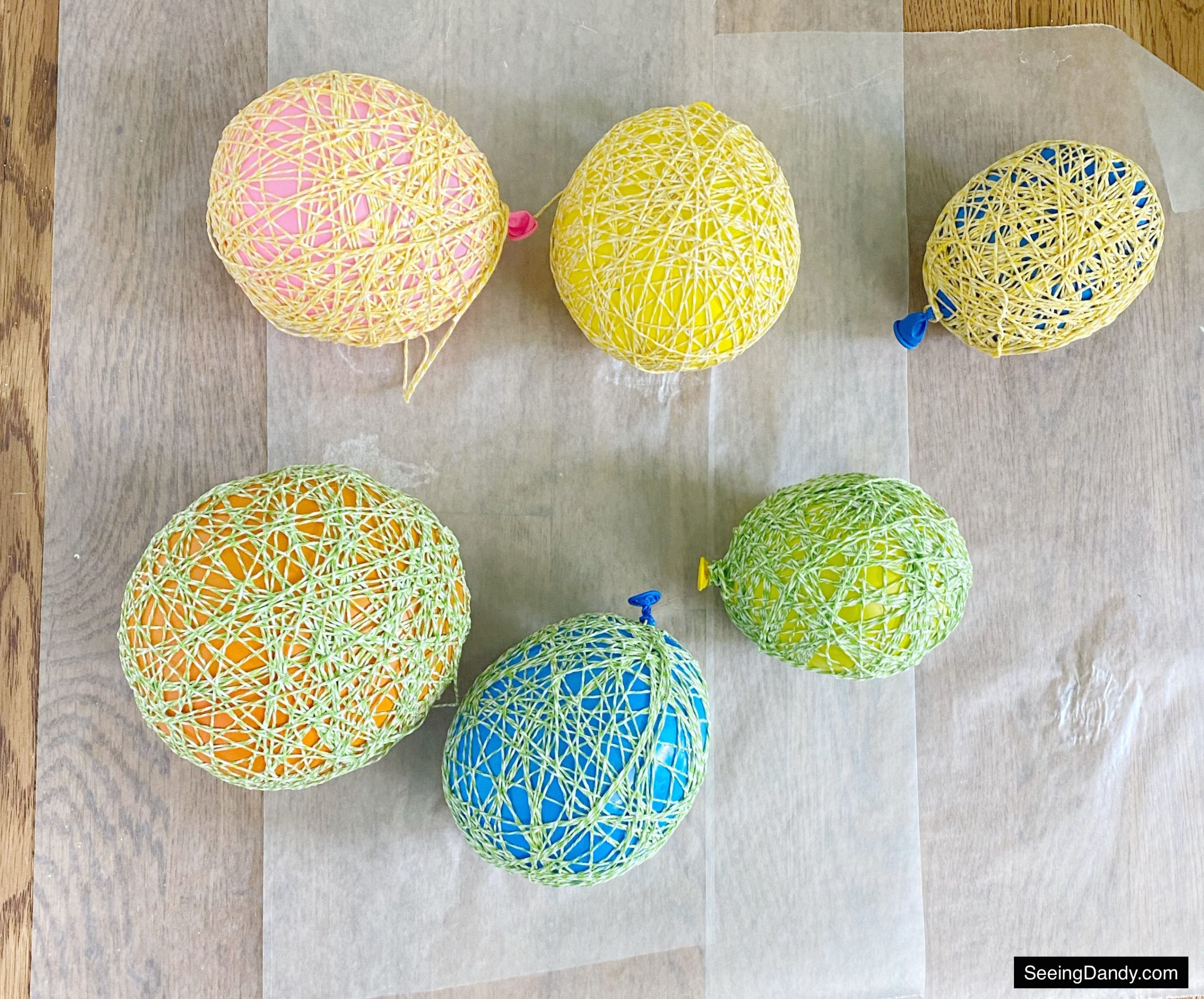 yellow green white string, string easter eggs, colorful balloons, yellow balloon, blue balloon, orange balloon, pink balloon, wax paper, diy string easter eggs